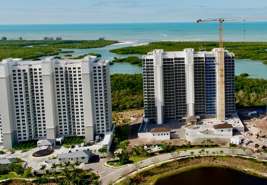 Kalea Bay's second tower (right) is under construction and scheduled to be completed in August.
