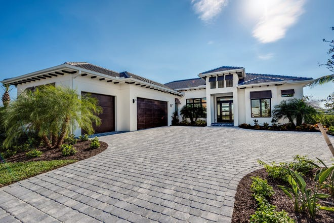 An exterior view of the Abaco model, recipient of an award for Overall Excellence in Construction and Design in the $1,500,001 - $2,000,000 category during the 2020 CBIA Parade of Homes.