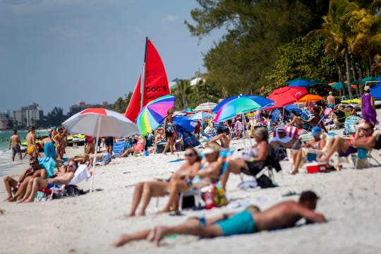 Crowds fill the shore at Bonita Beach in Bonita Springs on Wednesday, March 18, 2020.