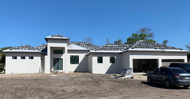 Construction is underway by Cintron Custom Builders on a custom pool home in Briarwood in Fort Myers.