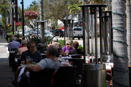 Customers enjoy lunch in the outside dining area of Cafe Milano, March 18, 2020, along 5th Avenue South in Naples.