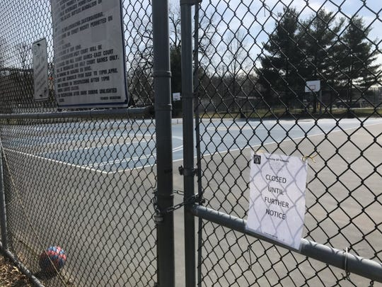 "No basketball in Teaneck. With town officials asking residents to ""self quarantine,"" public playgrounds, including tennis and basketball courts, were closed. Here, at Votee Park, someone left behind a basketball."