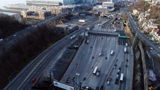 Aerial view of the Lincoln Tunnel entrance during the morning rush hour commute where few cars are seen on the road during the coronavirus outbreak on Wednesday, March 18, 2020, in Weehawken.