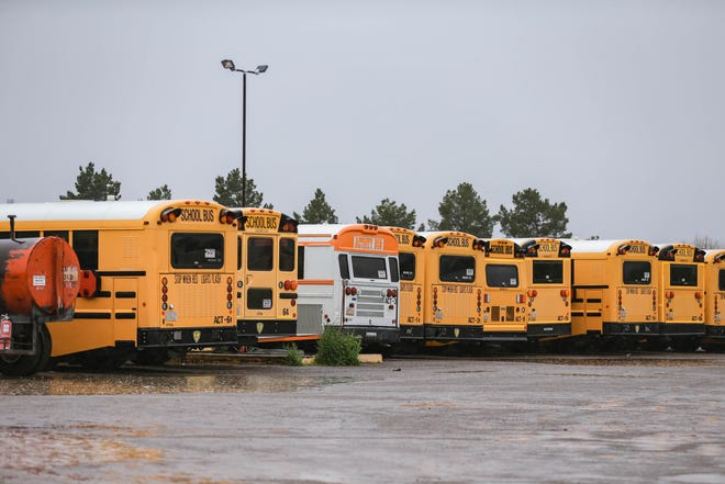 Buses sit empty at STS of New Mexico, the contractor providing transportation services to the Las Cruces Public Schools, while schools were closed due to the coronavirus pandemic on Wednesday, March 18, 2020.