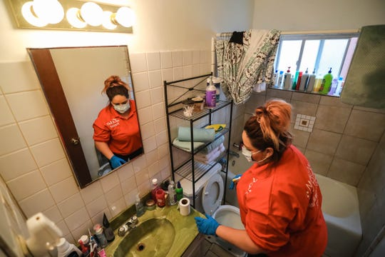 Lisa Loeffert, owner of Magic Maid Possible, cleans a home in Las Cruces on Wednesday, March 18, 2020.