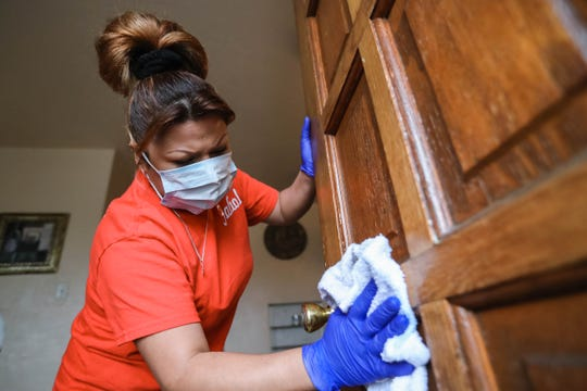 Fabiola Vieyra, of Magic Maid Possible, cleans a home in Las Cruces on Wednesday, March 18, 2020.