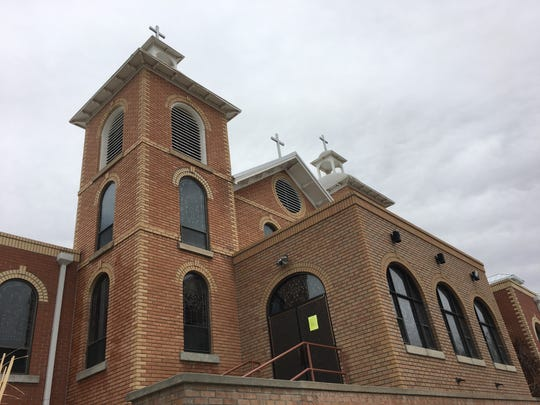 Sacred Heart Catholic Church is pictured, Wednesday, March 18, 2020, in Farmington.