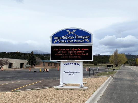 A vacant parking lot at White Mountain Elementary school became a student meal drive-thru pickup after mandate school closures.