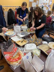 Kroger employees at the grocery store in Milford enjoy a meal provided by the Blue Grill in downtown Milford.