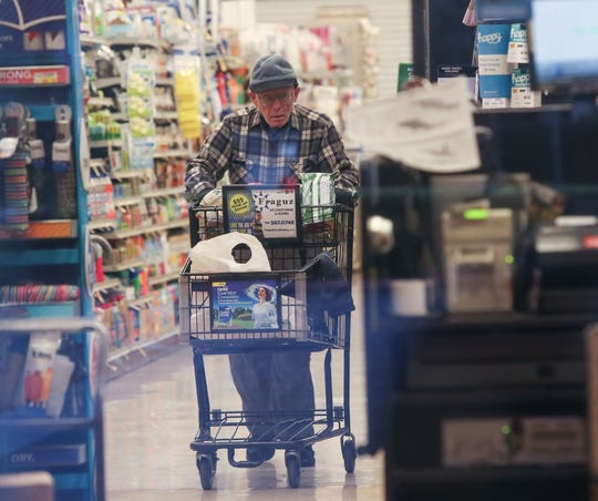 A man shops at Vons grocery which was open only for seniors between 7-9 a.m. as the coronavirus disrupts lives in Palm Springs, March 18, 2020.