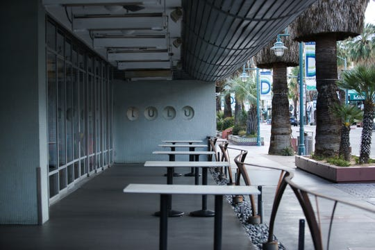 The patio area at Lulu California Bistro in downtown Palm Springs, Calif. sits empty on Tuesday, March 17, 2020.