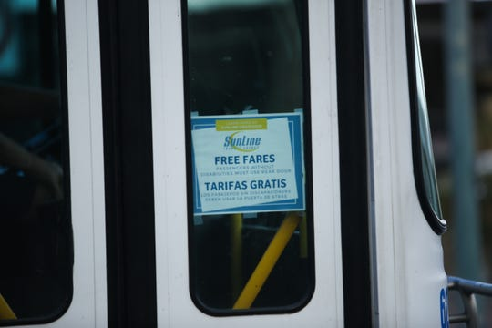 A sign informs the public of free fares for SunLine Transit Agency in response to the coronavirus outbreak and its effects on Tuesday, March 17, 2020.