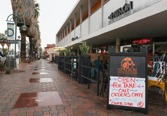 The usually busy downtown Palm Springs was mostly devoid of people as the coronavirus forces people to stay home and businesses to close, March 18, 2020.