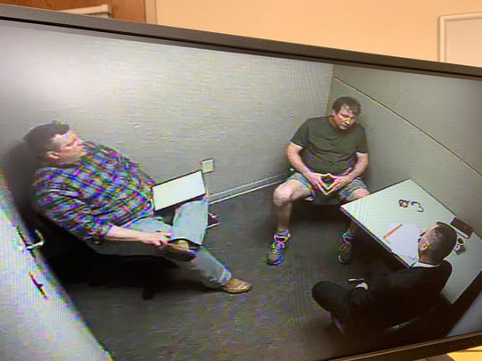 Pensacola Police Department Sgt. Danny Harnett (left) and Captain Chuck Mallett interview Daniel Leonard Wells on Wednesday afternoon in Pensacola. (Courtesy Photo)