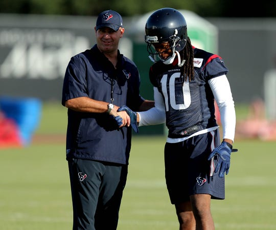 Houston Texans head coach Bill O'Brien shakes hands with Houston Texans wide receiver DeAndre Hopkins (10) during a Houston Texans training camp at Methodist Training Center.