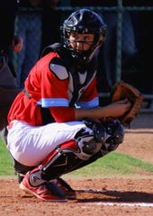 Mesa Community College baseball catcher Zach Wagner behind homeplate during a road game against Phoenix College on Feb. 15.