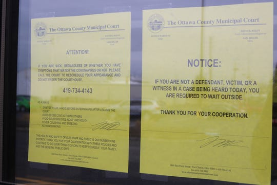 Notices posted at the entrance of the Ottawa County Municipal Court advise of the measures being taken due to the coronavirus.