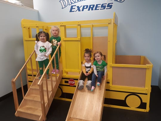 Chloe Kyrillidis, Cadence Tyger, Gianna Dreyer and Emma Walsh (from left to right) play on a bus in Dreamland Daycare in Poughkeepsie on Tuesday, March 18, 2020.