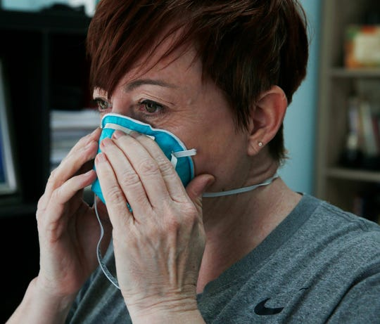 Christine MacNeil puts on a N95 particulate respirator, she is a registered nurse with the Dutchess County Medical Reserve Corps in Pine Plains on March 18, 2020.  MacNeil is also an instructor at Dutchess County BOCES.