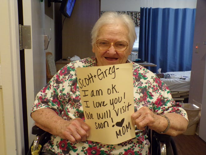 Normandie Ridge shares a photo on its Facebook page of a resident holding a sign for friends and family. Credit: Normandie Ridge Senior Living Community