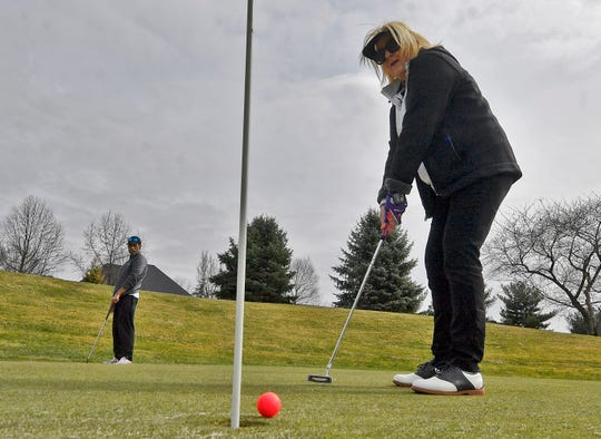 Melissa Shortino of York putts on the 11th green while enjoying a spring day at Heritage Hills Golf Club, Wednesday, March 18, 2020. Several area courses are still open during the pandemic.