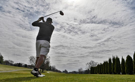 Alex Matarrita of York tees off on the 10th hole while enjoying a spring day at Heritage Hills Golf Club, Wednesday, March 18, 2020. Several area courses are still open during the pandemic.