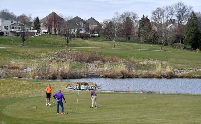 Golfers enjoy a day on the links at Heritage Hills Golf Club on Wednesday, March 18. A few days later, Pennsylvania golf courses were closed because of the COVID-19 pandemic. The state's golf courses will reopen on Friday, May. 1. John A. Pavoncello photo