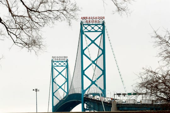 Vehicles move across the Ambassador Bridge between Detroit and Windsor, Ontario, as viewed from Detroit, Monday, March 16, 2020. Canadian Prime Minister Justin Trudeau says he is closing his country's borders to anyone not a citizen, an American or a permanent resident amid the coronavirus outbreak. (AP Photo/Paul Sancya)