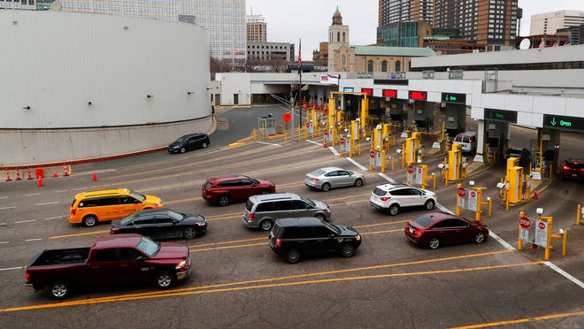 Vehicles enter the United States as a minivan drives to Canada in the Detroit-Windsor Tunnel in Detroit, Monday, March 16, 2020. Canadian Prime Minister Justin Trudeau says he is closing his country's borders to anyone not a citizen, an American or a permanent resident amid the coronavirus outbreak. (AP Photo/Paul Sancya)