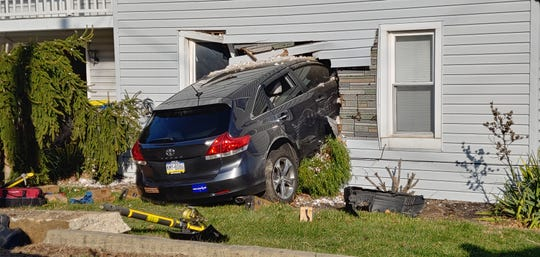 A man was taken to the hospital after his SUV left the road and crashed into a house in York Township Wednesday morning.