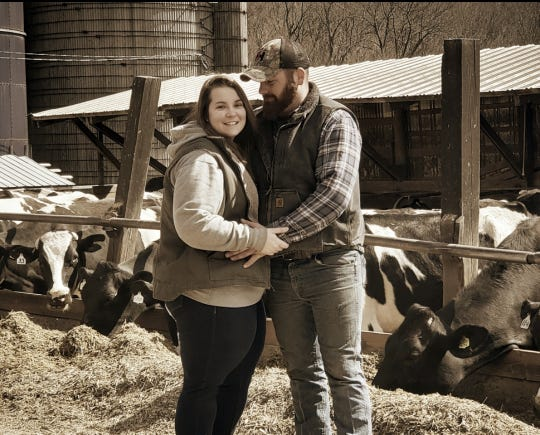Michael Bauer (right) asked his girlfriend, Teah Taylor, to marry him in February. They were in a place they both feel very comfortable, in their barn.