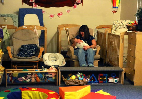 The Child and Family Research Center daycare hosts children on the final day before closing on the campus of the University of Nevada, Reno on March 18, 2020.