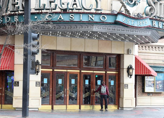 A man tries the door after reading the closed sign on the Silver Lagacy in downtown Reno on Wednesday morning March 18, 2020. The Nevada Governor Steve Sisolak ordered all nonessential businesses and casinos to be closed to prevent the spead of the Coronavirus.