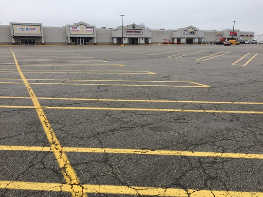 One shopping plaza along National Road East had a nearly empty parking lot Wednesday except for the Save-A-Lot store.