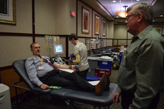 Reid Health CEO Craig Kinyon donates blood during the hospital's St. Patrick's Day blood drive on Tuesday, March 17, 2020.