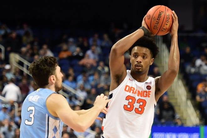 Syracuse's Elijah Hughes looks to pass against Andrew Platek of the North Carolina during the ACC Tournament. Hughes may opt to leave Syracuse for the pros instead of returning for his final season.