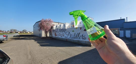Divine Distillers, Salem's only distillery, as joined with liquor industry counterparts worldwide in making a batch of 90% alcohol sanitizer that can be used to clean hands or surfaces.