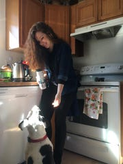 Education reporter Natalie Pate takes a break while working from home with her dog Bandit, a 5-year-old pit bull-type dog.