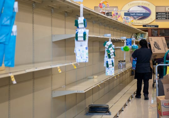A nearly empty bath and facial tissue aisle inside a Safeway in Salinas on Saturday, March 14, 2020.