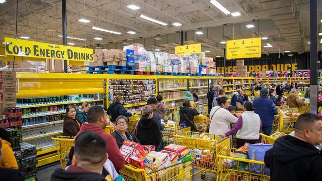 Hundreds of people try to pay for their groceries inside Food 4 Less on Saturday, March 14, 2020.