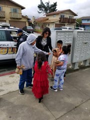 Zandra Jo Galvan superintendent of the Greenfield Union School District helps hand out lunches to kids in her district Monday, March 16, 2020.