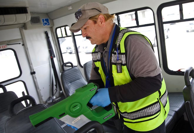 Mark Pilon sprays disinfectant on a bus in the Concho Valley Transit fleet on Wednesday, March 18, 2020 as an enhanced measure against the coronavirus.