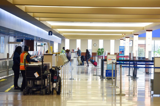 Lines to check in for flights are practically nonexistent due to concerns about the coronavirus on Wednesday, March 18, at the Sioux Falls Regional Airport.