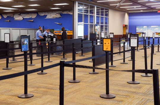 A single traveler passes through the TSA checkpoint on Wednesday, March 18, at the Sioux Falls Regional Airport. Very few travelers are flying due to concerns about the coronavirus.