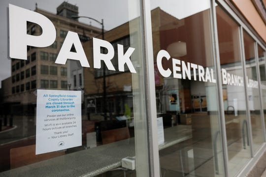 A sign alerts patrons that the Park Central Branch Library in downtown Springfield is closed on Wednesday, March 18, 2020 due to the coronavirus.
