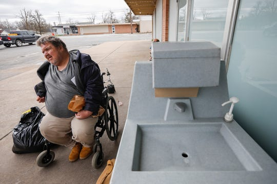 Shawn Young talks about being homeless and how the coronavirus is affecting him while waiting for a meal at the Connecting Grounds on Tuesday, March 17, 2020.