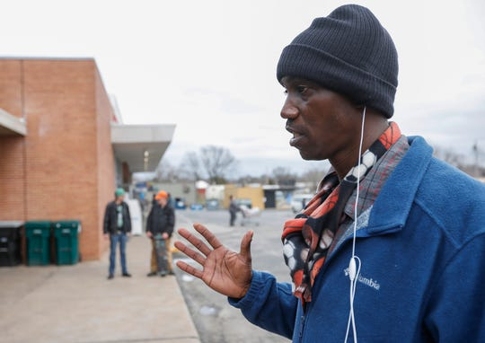 Markus Murray talks about being homeless and how the coronavirus is affecting him while waiting for a meal at the Connecting Grounds on Tuesday, March 17, 2020.
