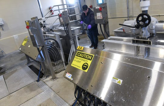 Signs are posted on an ultraviolet light system used to kill bacteria and viruses Tuesday, March 17, 2020, at the St. Cloud Wastewater Treatment Plant.