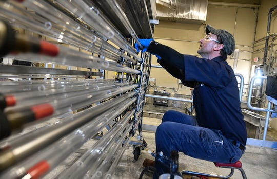 Mark Weyer performs maintenance on part of an ultraviolet system used to kill bacteria and viruses Tuesday, March 17, 2020, at the St. Cloud Wastewater Treatment Plant.