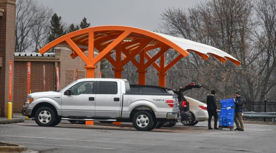 Customers receive their items at the Walmart pick-up area Wednesday, March 18, 2020, in Sartell.